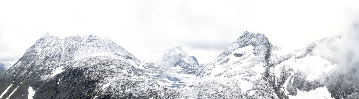 Aerial panoramic of Store Venjetinden and Olaskarstinden mountains covered with snow, Venjesdalen valley, Romsdalen, Rauma, Norway, Scandinavia, Europe - RHPLF12848
