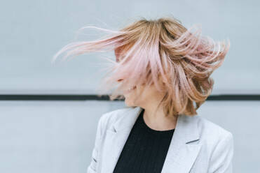 Woman moving her pink hair - KIJF02814