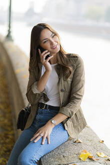 Young brunette woman using smartphone in Verona, Italy - GIOF07728