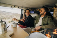 Happy young couple inside camper van, Almeria, Andalusia, Spain - MPPF00253