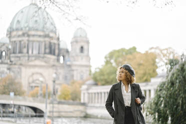 Tourist woman in the city with Berlin Cathedral in background, Berlin, Germany - AHSF01350