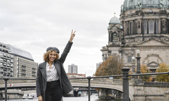 Portrait of cheerful tourist woman in the city with Berlin Cathedral in background, Berlin, Germany - AHSF01353