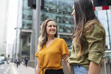 Happy lesbian couple in the city, London, UK - FBAF00958