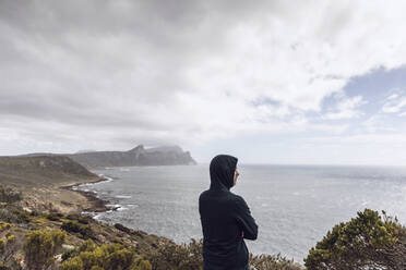 Man looking to the sea, Cape Point, Western Cape, South Africa - MCF00338