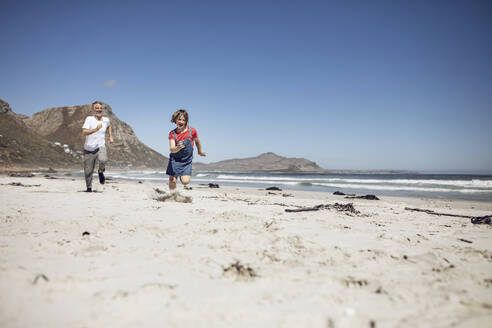 Father and daughter having fun together on the beach, Cape Town, Western Cape, South Africa - MCF00368