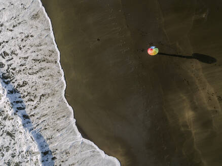 Aerial view of rainbow colors umbrella at the beach, Kedungu beach, Bali, Indonesia - KNTF03733
