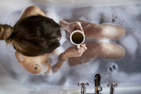 Woman having a relaxing bath and a cup of coffee in the bathtub - VEGF00837