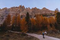 Man hiking at Dolomites Alps in the morning, Cortina, Italy - MRAF00434