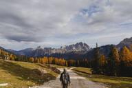 Female hiker hiking at Dolomites Alps, Cortina, Italy - MRAF00452