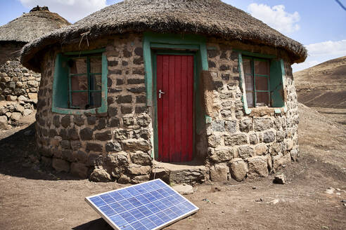 Typical house with solar panel, Lesotho, Africa - VEGF00847