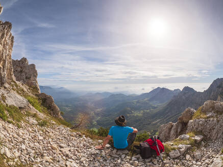 Hiker looking at view in the mountains, Recoaro Terme, Veneto, Italy - LAF02423