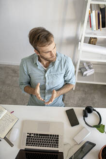 Top view of man sitting at desk in office - VPIF01783