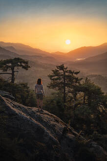 Female hiker standing on viewpoint, Albertacce, Lac de Calacuccia at sunrise, Haute-Corse, Corsica, France - MSUF00037