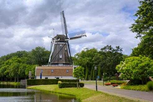 The Netherlands, Utrecht, Bunschoten-Spakenburg, Stadsspui, Wieken Brasserie, Windmill by river - LBF02800