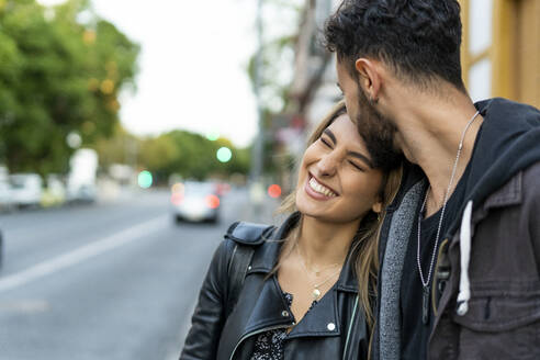 Portrait of happy young woman with her boyfriend - ERRF02175
