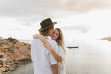 Young couple in love in front of the sea, Ibiza, Balearic Islands, Spain - AFVF04269