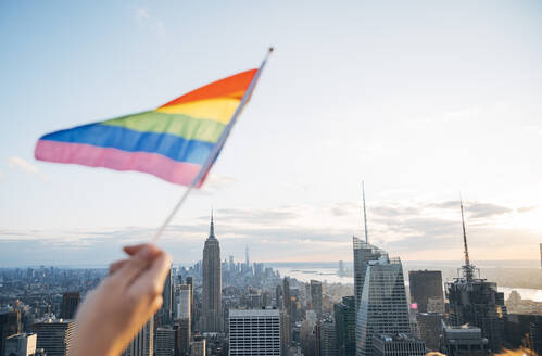 Hand waving LGBT flag in NYC, USA - JCMF00295
