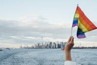 Hand waving LGBT flag in NYC, USA - JCMF00298