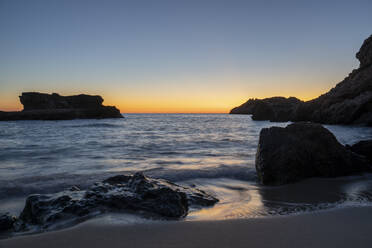 Beach during sunset. Ibiza, Balearic Islands, Spain - AFVF04299