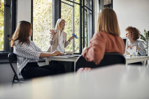 Businesswomen having a meeting in office - ZEDF02749