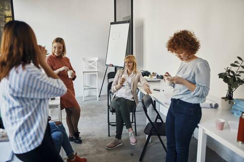 Businesswomen having a break in office - ZEDF02779