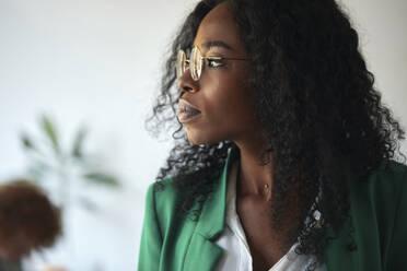 Portrait of a businesswoman in office looking sideways - ZEDF02815