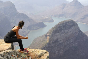 Woman on the top of a rock at Blyde River Canyon, South Africa - VEGF00864
