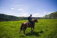 Horse rider on green landscape, Calgary, Canada - ISF22972