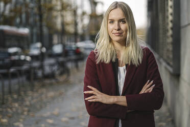 Portrait of blond businesswoman looking at camera - AHSF01393