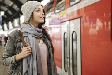 Young woman at the station platform as the train comes in, Berlin, Germany - AHSF01454