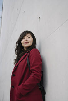 Portrait of modern businesswoman leaning on a wall - AHSF01532