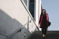 Modern businesswoman going to metro station - AHSF01538