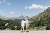 Back view of kissing senior couple, Jaca, Spain - AHSF01559