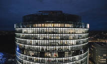 View to lighted modern office building at night, Potsdamer Platz, Berlin, Germany - AHSF01574