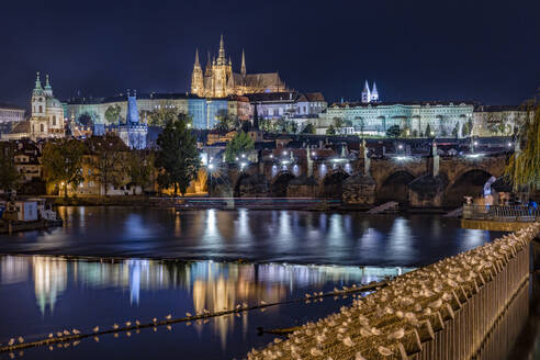 Czech Republic, Prague, view of castle over charles bridge at night - YRF00220