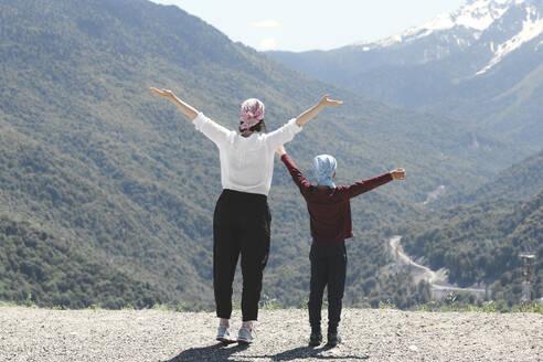 Mother and son enjoying mountain view, Sochi, Russia - EYAF00729