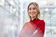 Portrait of a confident young businesswoman wearing red shirt - DIGF09011