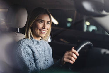 Portrait of happy young woman driving a car - DIGF09020