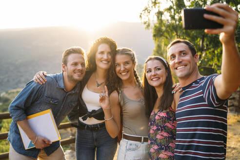 Happy friends taking a selfie in rural landscape - MPPF00341