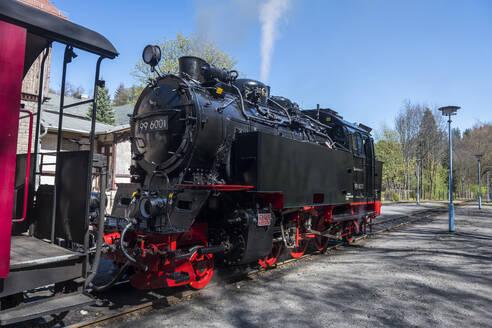 Germany, Saxony-Anhalt, Quedlinburg, Steam locomotive waiting at railroad station - RUN03482