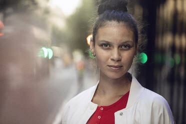Portrait of confident young woman in the city - MCF00435