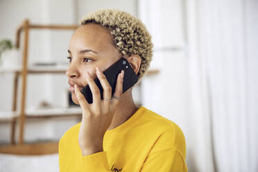 Portrait of young woman on the phone at home - MCF00438