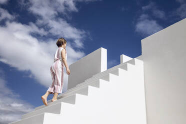 Little girl climbing stairs - MCF00494