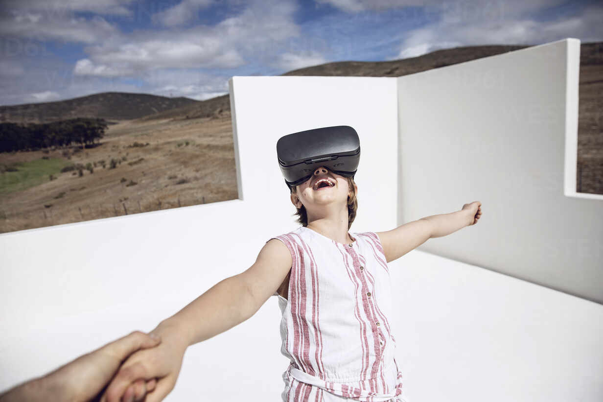 Girl looking through VR goggles in open space - MCF00509 - Maya Claussen/Westend61