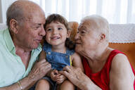 Happy grandparents with little girl at home - GEMF03314