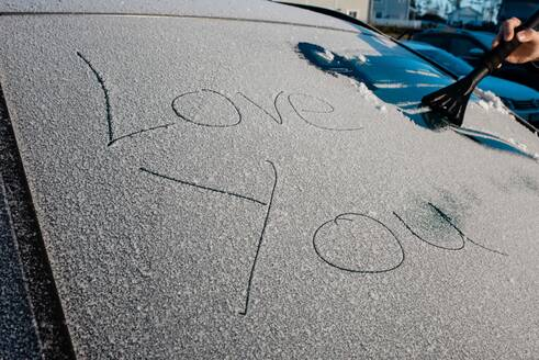 I love you message on the windscreen of a frosty car in winter - CAVF69588