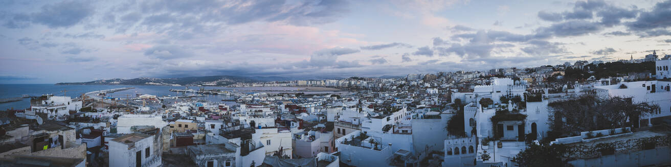 Panoramic view of cityscape against cloudy sky during sunset - CAVF69630