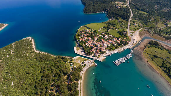 Aerial view of man-made canal crossing the city of Osor, Croatia. - AAEF05929