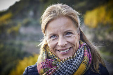 Portrait of a smiling mature woman outdoors - FMKF06047