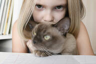 Portrait of girl with a cat at home - EYAF00752